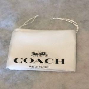 "Coach dust bag 23.5"" length and 19.5"" width"